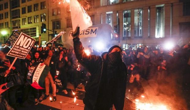Sokaklar karıştı... Trumpın başkanlığına Maskeli Protesto