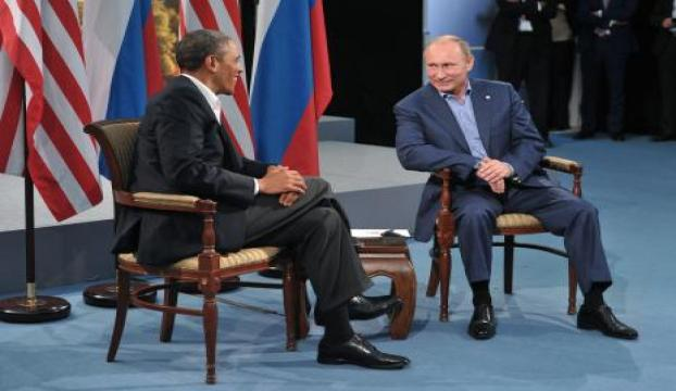 Putin, Obama ile ayak üstü görüştü